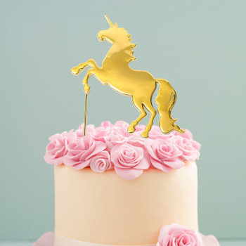 Unicorn Cake Topper Gold Plated On A Cake