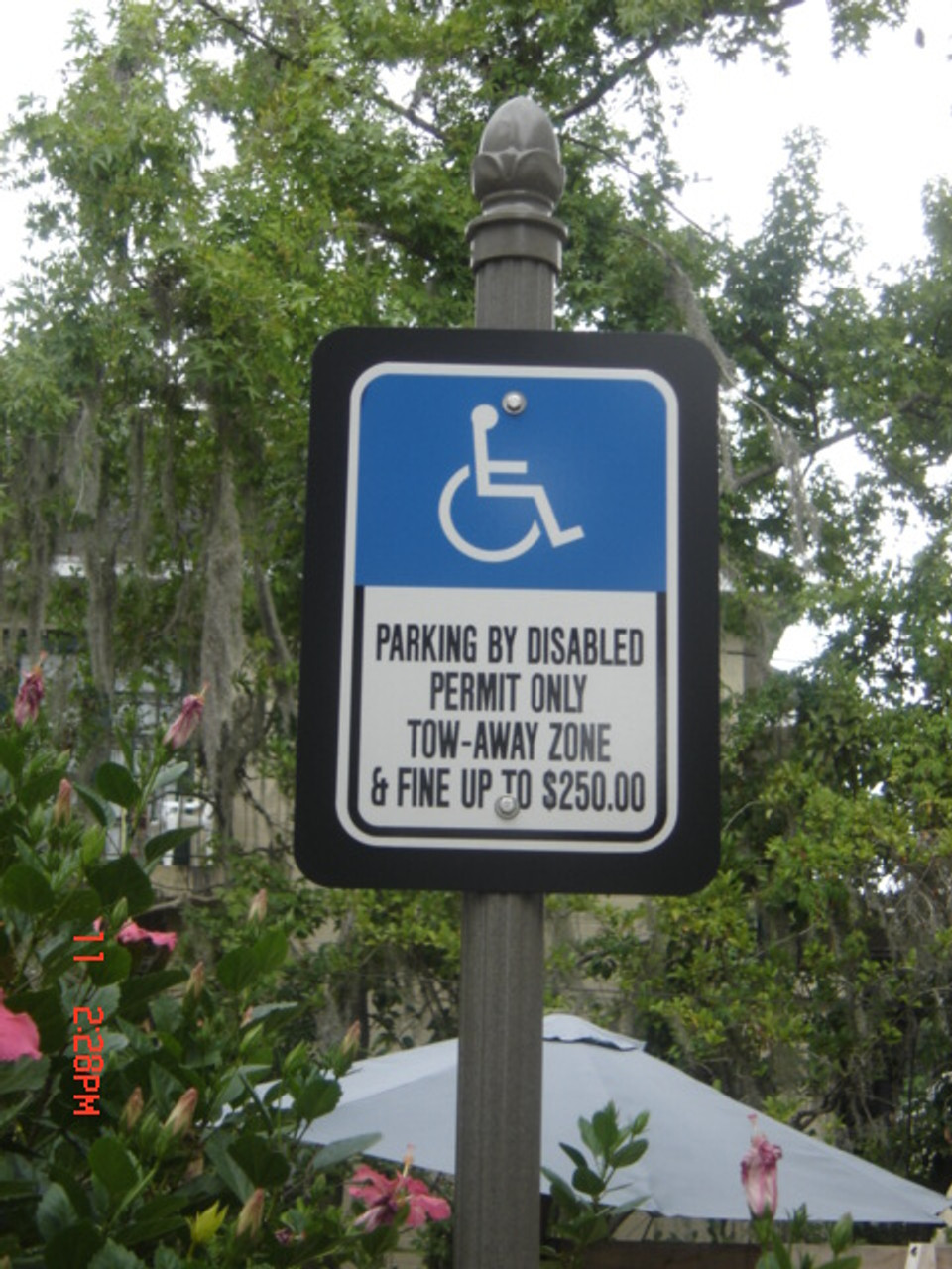 Fluted Round Pole, capped with Acorn Finial.  Handicap Parking Sign with over sized Aluminum Blank. To request a quote, please include dimensions specific to your project.