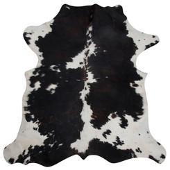 dark brown and white cowhide rug