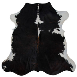 dark brown and white cowhide rug