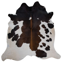 reddish brown cowhide rug