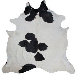 white and black spotted rug