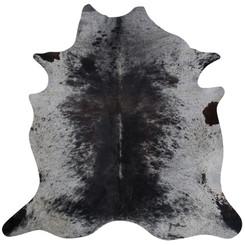 black white and grey cowhide rug