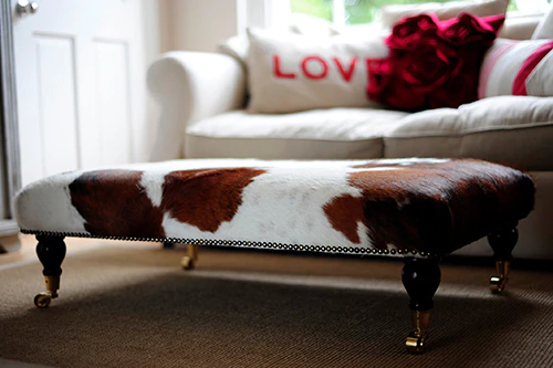 The Natural Beauty and Practical Features of Cowhide Footstools