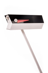 """This mid-century modern mailbox design was inspired by those produced in the 1950s and 1960s. Two-tone color brings out the design's clean lines. Colors are original Eichler Exterior Accent Colors. Now you can have a mailbox that looks great with your mid-century, modern, and/or contemporary home.  The perfect blast from the past for your Atomic Ranch!  Crafted in America, the way it used to be.  Material: 20 gauge galvannealed steel, same as the 50s-70s [75%+ thicker than most mailboxes made today] Paint: powder coated inside and out, baked at 400 degrees [environmentally friendly] Anodized aluminum flag cap and door pull Size: 7"""" wide x 7.75"""" high x 21.25"""" long"""