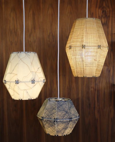 From left to right: pear shape, ball shape, diamond shape. Finishes: ivory with gold/black swirl, grey swirl, rattan.