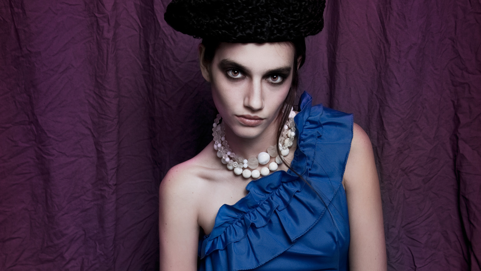 The Rabbit Hole vintage clothing Miami fashion editorial blue evening gown