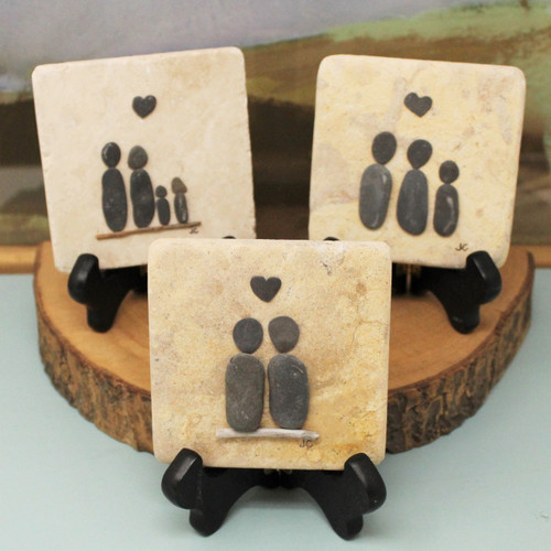 """These tiles are made to represent close relationships between people. The stones are pulled directly from skaneateles lake, on the artist's property. Measuring 3.75"""" square, these tiles are propped up with wooden stands that are included with purchase. Handmade by Jennifer Campanile in Skaneateles, NY."""