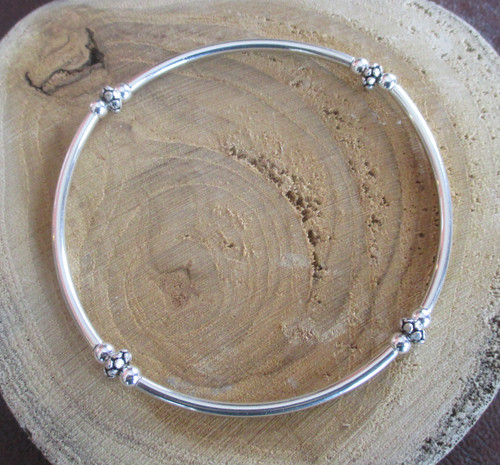 Sterling silver beaded stretch bracelet made by Marcellus artist Lisa Twombly of Estancia Designs.