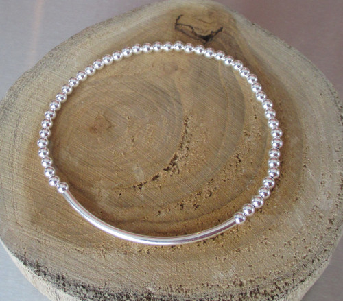 Sterling silver beaded stretch bracelet made by Marcellus artist Lisa Twombly of Estancia Desings.