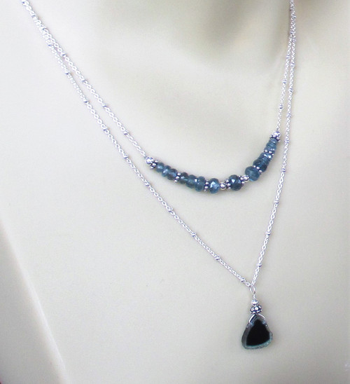 Blue Tourmaline triangle sliced stone on a sterling silver beaded chain with a heart clasp. Handmade by Marcellus artist Lisa Twombly of Estancia designs.