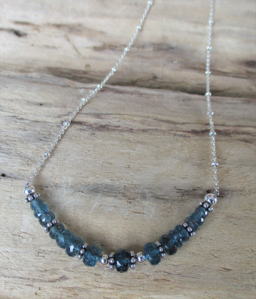 Moss blue kyanite and sterling silver beaded necklace on a silver chain with a heart clasp. Handmade in Marcellus, NY by Lisa Twombly of Estancia Designs.