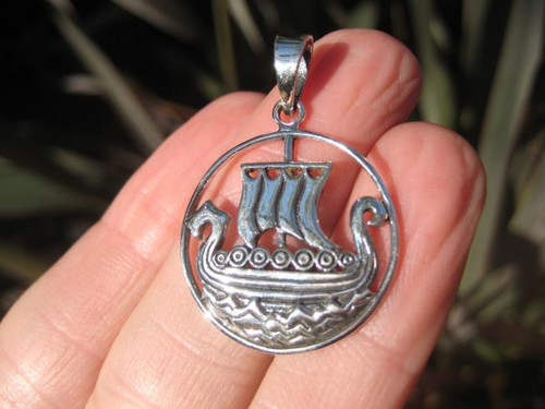 This is image one front view viking boat ship pendant that was made in Thailand