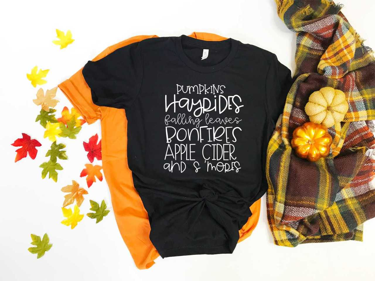 Pumpkins Hayrides Falling Leaves Bonfires Apple Cider and S'more Softstyle Tee