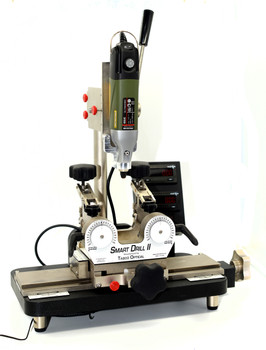 Smart Drill II with complete NEW Digital electronics package: Counters, Encoders, Scales, Box and Wiring same as used on the current Smart Drill III v4.  Starting with a Smart Drill II trade-in we completely dismantle the entire machine clean it, replace non-functioning, worn or bent parts then replaced all glide materials in drill press and lens table.  This machine shows cosmetic worn and use.  We added important updates to improve function including the front support bracket, lens table position lock, etc.  Reassembled, align and test the Smart Drill.  This machine can provide excellent value without buying a new Smart Drill III, please note this machine has been used and has cosmetic damage.  Please note we do not repaint and or replate parts for appearance.  We sell the machines as complete systems along with the Smart Drill we include setup to your blocking system, Ten count package of assorted drill bits, our K4000 and K4100 Rimless Repair Kits, CD with Rimless Drilling formula Charts, Axis alignment bar and Packaging and Shipping to any US address.   Specification for this Refurbished Smart Drill II comes with newest model most advanced Smart Drill counter system.  This system makes manual rimless lens drilling easy with digital readout for processing all types of three-piece mountings.  Digital counters with 0.04 mm accuracy provide the most precise measurements in the industry.  Very little training required.  Most rimless jobs can be drilled in about two minutes! Complete system including supplies and setup for your blocking system.  Shipping to any US & Canada location included.  Features:  - New enhanced digital display - 0.04mm Accuracy for easy read-out repeatability - Adapts to all edger blocking system with lens arms adjustable for edger axis - Variable speed motor 3,000 to 20,000 RPM with Tabco's Precision drill collet - Lens Table designed for quick operation - Lens Table & Drill Press lock for shaped operations on Flair frames  Complete Drilling 
