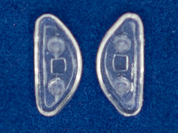 Minifits Silicone nose pads added to plastic frames to provide a true nose pad on plastic frames.  The nose pads measures 14mm Long x 6mm wide and 1.5mm thick mounted by carefully adding two holes (pockets) to frame.  Each bag contains 10 pairs of nose pads and 30 templates (drilling guides) and instructions