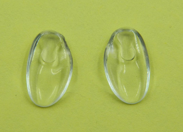 """Image of a pair of NP653 nose pads Replacement Silhouette nose pads made from Premium grade semi-soft and flexible PVC this nose pad measures about 13mm long by 7.5mm wide and 2.2mm think Shape is """"D"""" fit there are Left and Right side pads. The mount is a unique Silhouette design using wire bent into a teardrop shape. The bent wire is inserted into the top end of the nose pad. These nose pads were designed to replace the original Silhouette nose pads that are very hard.  This product also fits some Adidas frames a Silhouette line. Packaged and sold 10 pair bags."""