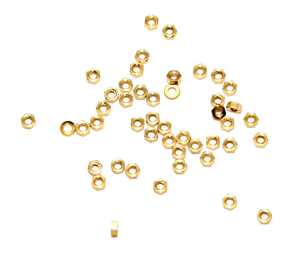 """Machined Hex Nut standard Metric thread M1.4 also 1.40UNM thread, .30mm pitch (standard for this thread)  ACF (across the flats) 2.25m / .089"""", Material: Nickel Silver w/ Gold finish. Packaged Price per 100 pieces with bulk pricing available."""