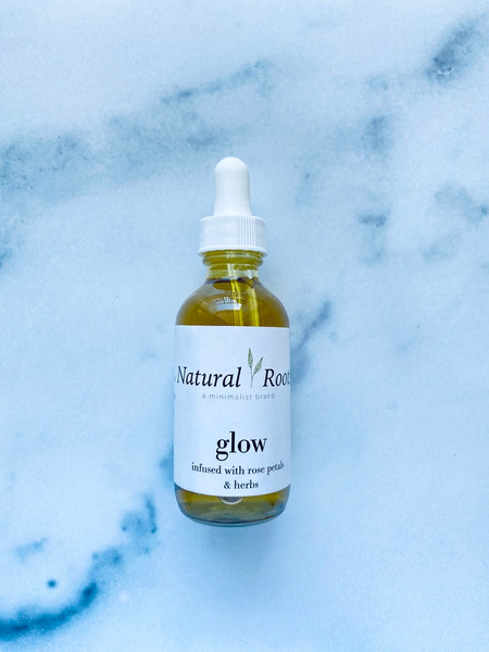 Natural Roots 'Glow' Facial Oil bottle with leaves