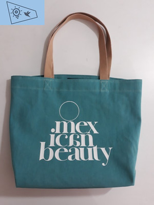 "Grean denim bag Mariana Mosqueda with ""Mexican beauty"" stamped on it."
