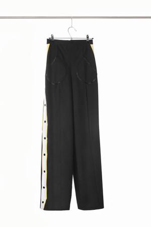Pantalon basquetball en tela impermeable con broches laterales