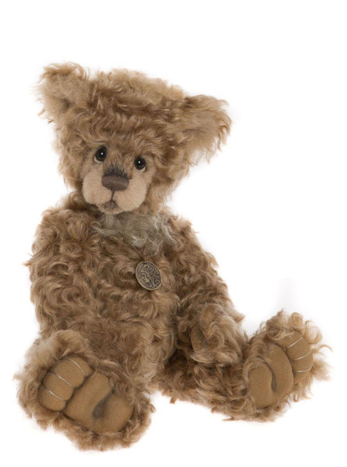 Goosebumps is a traditional-style mohair bear from the 2018 collection.  He features curly, soft brown shades of mohair with a bear-utiful pendant necklace.  He is eagerly awaiting his new home, so adopt him today and add him to your ever-growing hug!