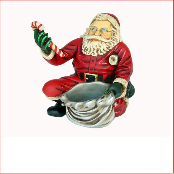 The Poly-resin Santa Claus Kneeling is the favourite for a table centre piece, kids adore the little Santa as many fill the little sack with little presents or lollies.