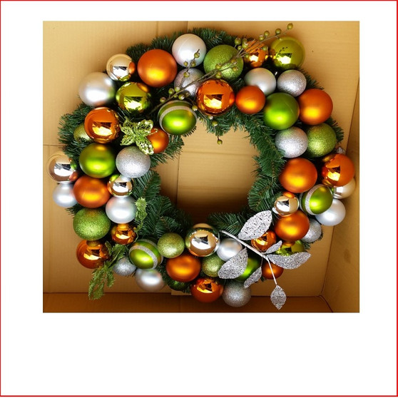 Decorated Christmas Wreath Contemporary style by our team of designers at Father Christmas tailored to your colour theme and expectations. Contact us by email info@fatherchristmas.net.au or ph: 1300 455 298 for an extensive Quote on your requirements.