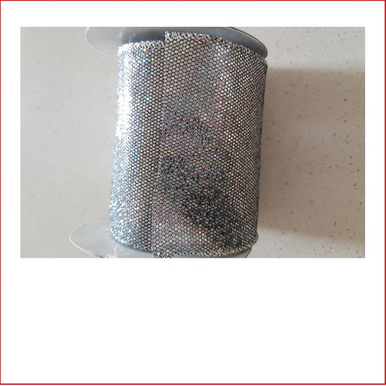Christmas Ribbon-Silver Lame with Sparkles-100mm looks great with the final touch of the glitter which sparkles through the bow. Ribbon-Silver Lame with Sparkles-100mm can be used for  garlands, wreaths, christmas trees and wall sequoia's. Ribbon-Silver Lame with Sparkles-100mm is very classy and a favourite for corporate clients. The colour silver is stylish and contemporary. DIY single bows or double bows, wrap the christmas tree with ribbon, you can make the size of your bow as large as you need. Extra thick width ribbon 100mm which the corporate sector love, lush and beautiful.