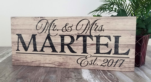 wooden family name sign