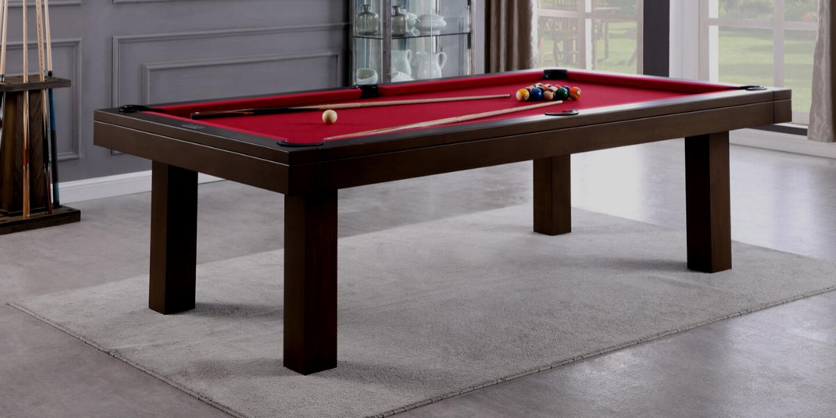 wood and metal pool table with black felt