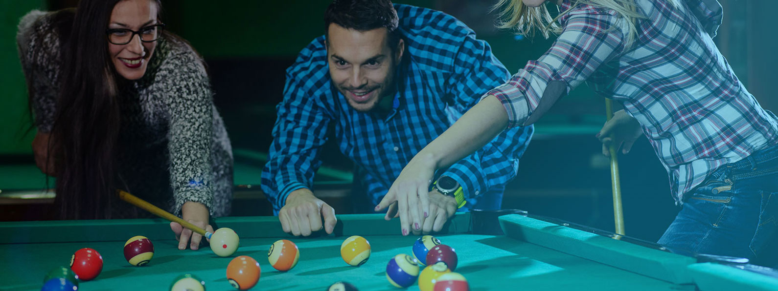 People enjoying a game of billiards