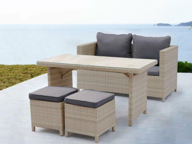 4-piece wicker outdoor dining set with blue cushions