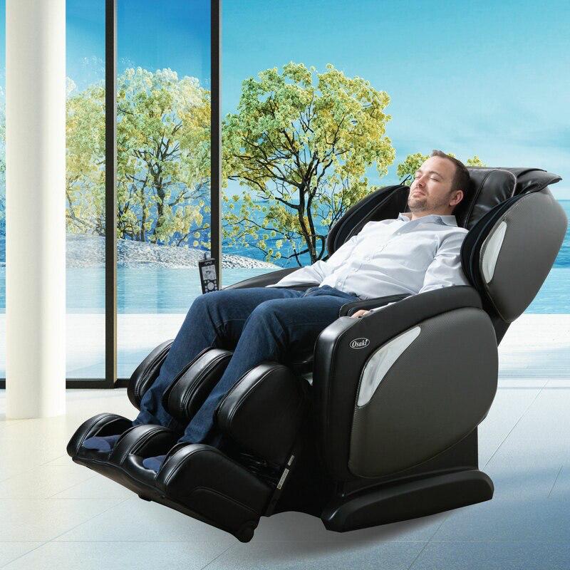 man sitting in black massage chair