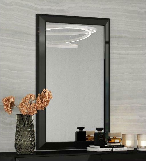rectangular mirror with black frame hanging over a mantel
