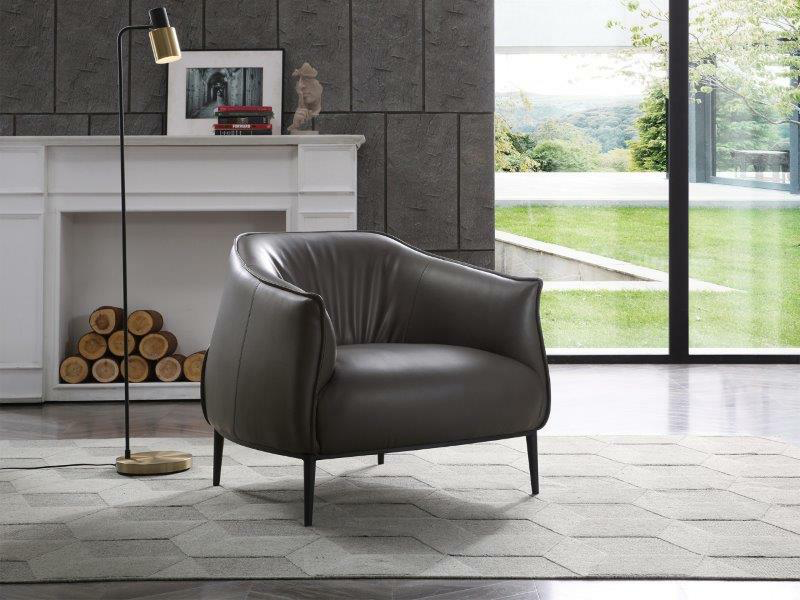 dark gray lounge chair in front of a faux fireplace