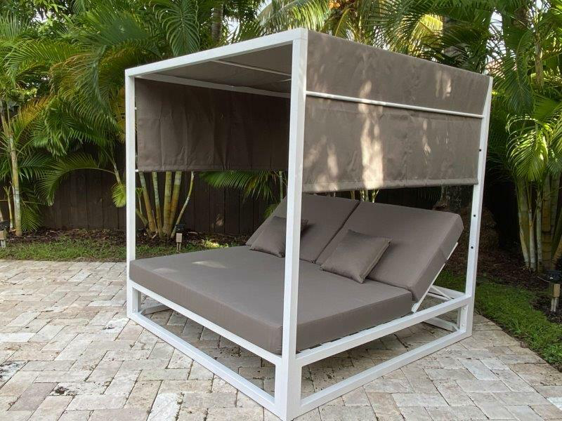 Ava outdoor gazebo bed on white brick patio