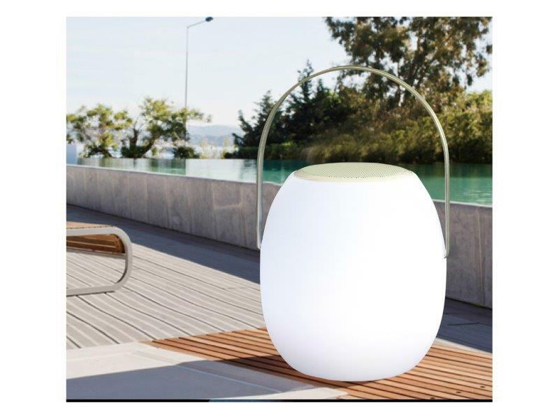 white portable LED speaker by a pool