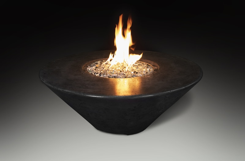 round fire pit table with flames lit