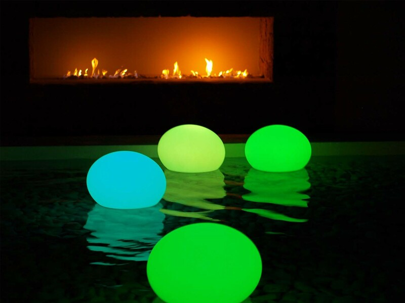 round, colorful LED lamps floating in wate