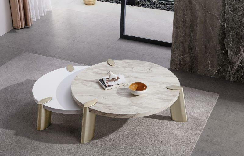 round white coffee table with smaller matte table under it