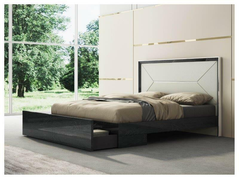 white and black king bed against a tan and gold wall