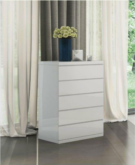 white chest of drawers against curtains