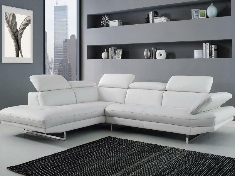 white leather sectional in a grey living room