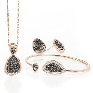 This amazing set of rose gold plated jewelry is made from the best Austrian crystals to resemble the natural formations found of crushed black diamonds. To finish off this dramatic look is a band of clear Austrian crystals set within white enamel. This set includes a pendant, earrings and matching freesize bangle all presented in a gift box.