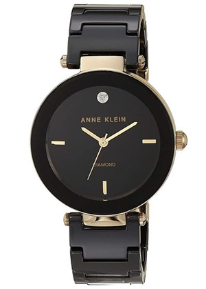 """Sleek and undeniably elegant, the bold black ceramic design is offset by the detailed gold tones, with a genuine diamond at the 12 o'clock position for that finishing 'wow' factor.  • Round, 33 mm, black glossy dial • Band width: 10 mm """