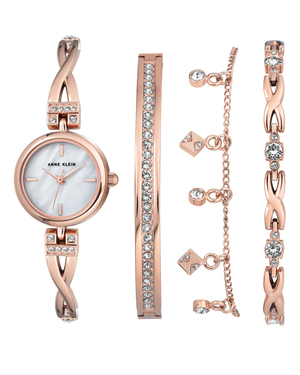 Let your style shine with this 4 pc. Rose Gold-Tone Box Set. This gorgeous set not only features a bangle watch with a Mother of Pearl Dial but also 3 bracelets with Swarovski Crystals. It makes the perfect gift.