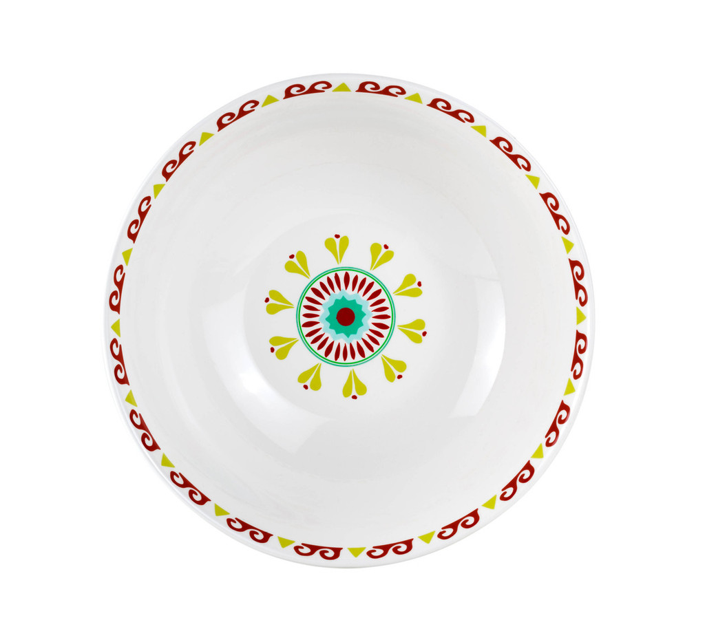 alternate view of a short wide serving bowl featuring a multicolor design of greens, yellows and reds showing the interior, which is primarily white but features a design around the rim and a pattern in the middle