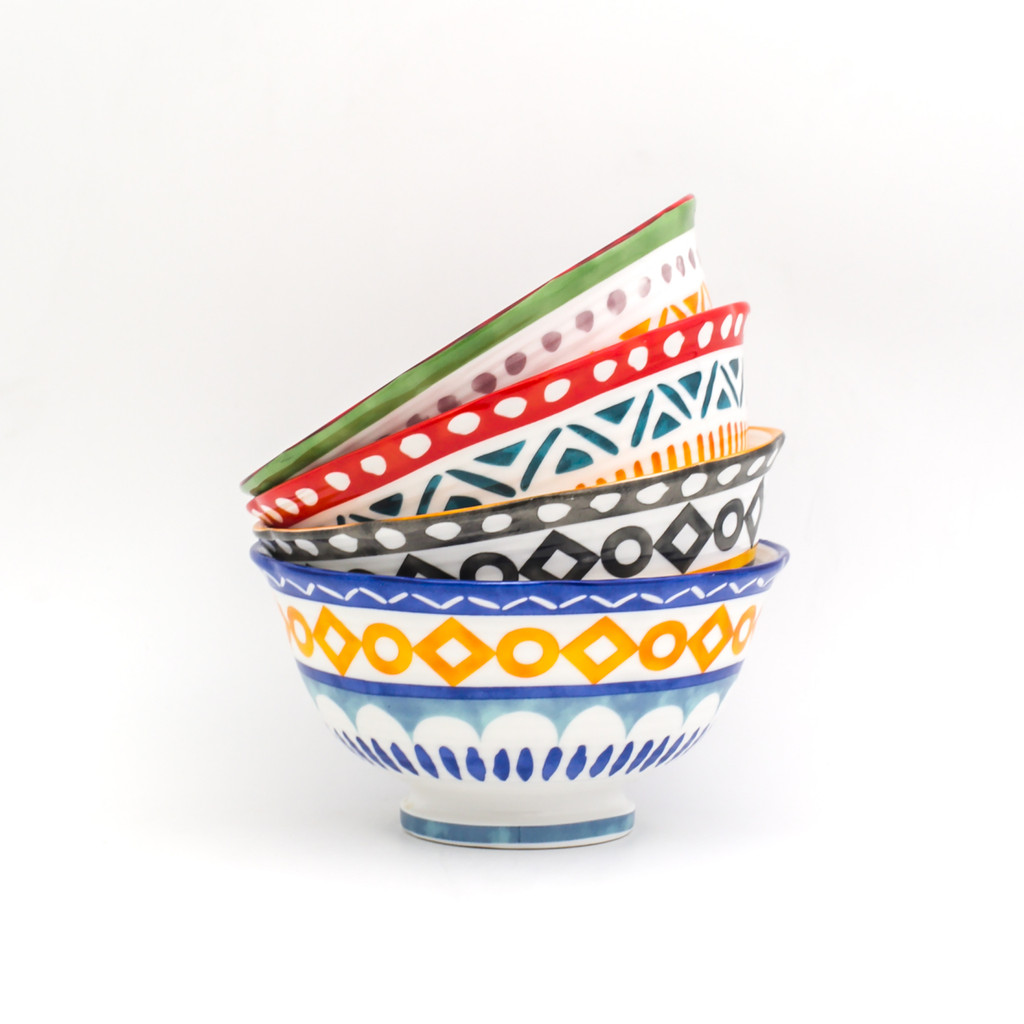 single stack of four bowls with assorted colors and geometric patterns.