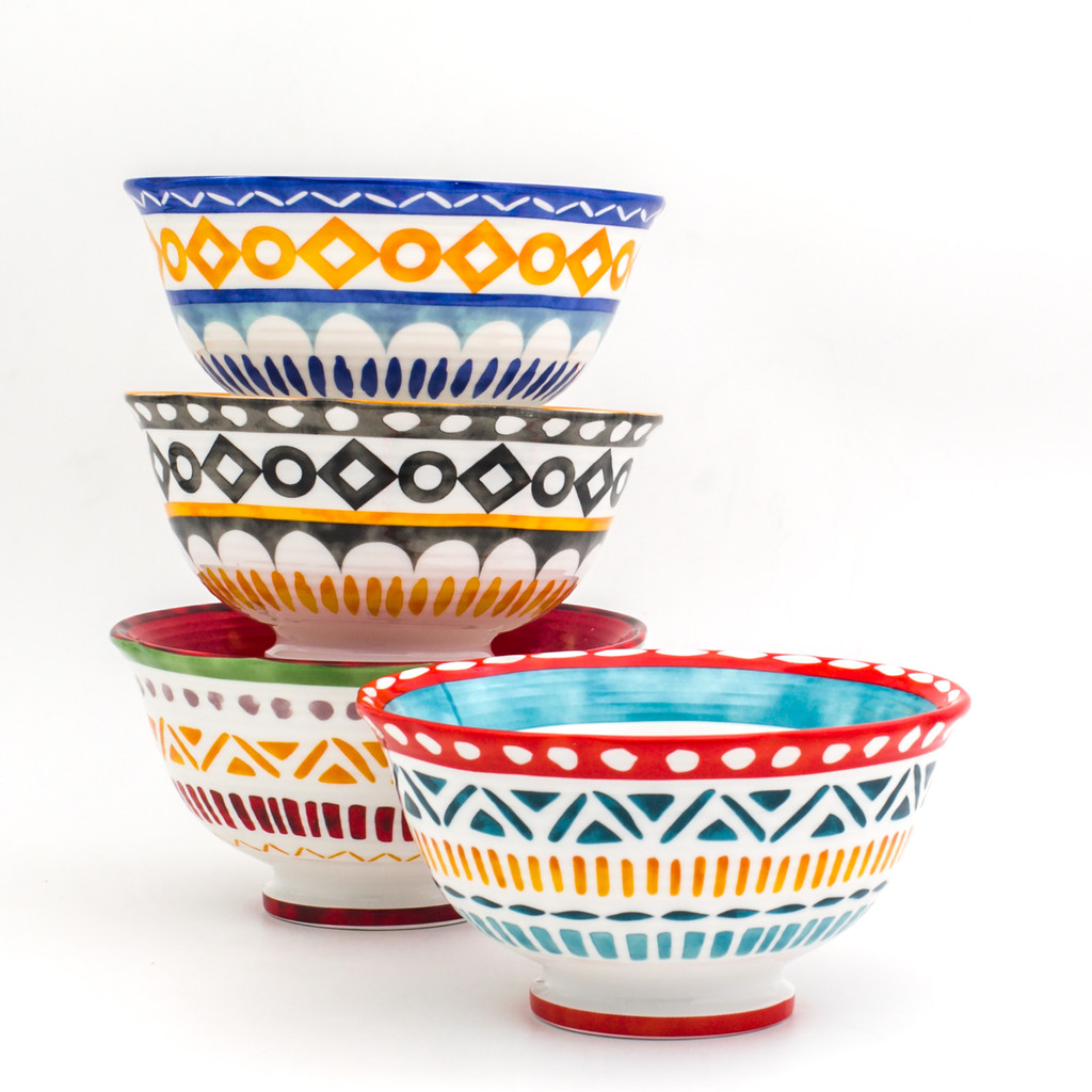 one tall stack of three bowls with assorted colors and geometric patterns. a fourth bowl sits in front of the stack